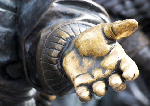 A photo of an outstretched hand. Retrieved from https://pixabay.com/en/hand-statue-culture-old-open-hand-2722236/